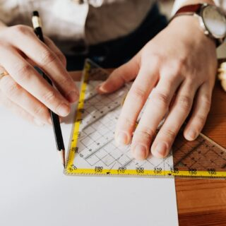 photo of person using ruler