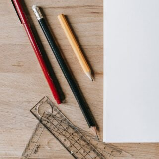 pencils and rulers near sheet of paper